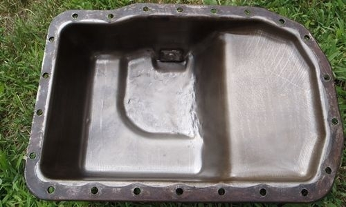 [Image oil pan dented]